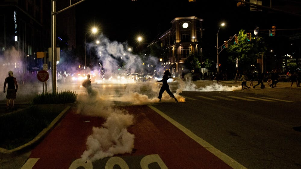 Tear gas creeps up the street May 30 in Indianapolis. Police enforcement used tear gas to break up the protest in response to the police killings of George Floyd in Minneapolis, Breonna Taylor in Louisville, Kentucky, and Dreasjon Reed in Indianapolis.