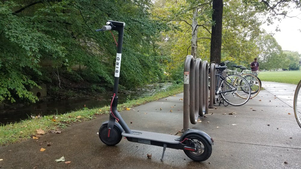 A Bird scooter sits outside the Indiana Memorial Union on Sept. 27, 2018. The electric scooter announced the temporary removal of Bird scooters from Bloomington due to low ridership.