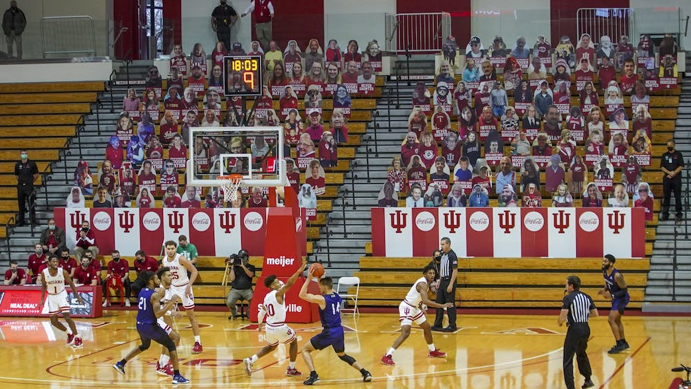 The IU men's basketball team plays against the University of North Alabama in front of a crowd of cardboard cutouts Dec. 13 at Simon Skjodt Assembley Hall. IU defeated North Alabama 87-52.