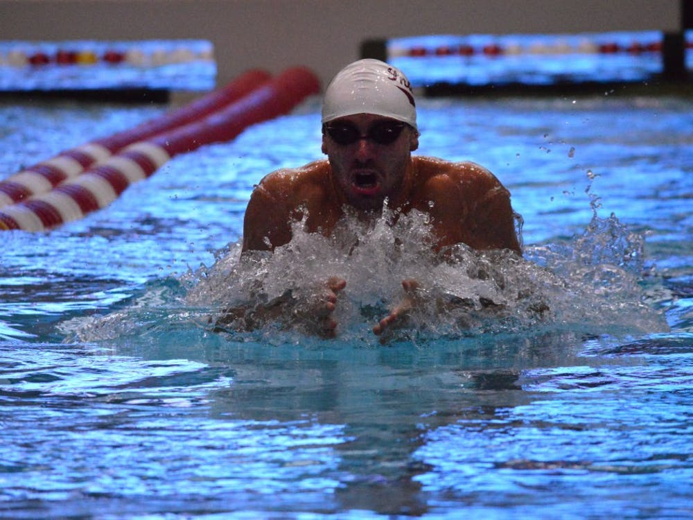 Then-sophomore Blake Pieroni dives off the starting block during the 100-yard breaststroke during a 2015 meet against Cincinnati at the Counsilman Billingsley Aquatic Center. Pieroni won the 100 freestyle at the Phillips 66 National Championships.