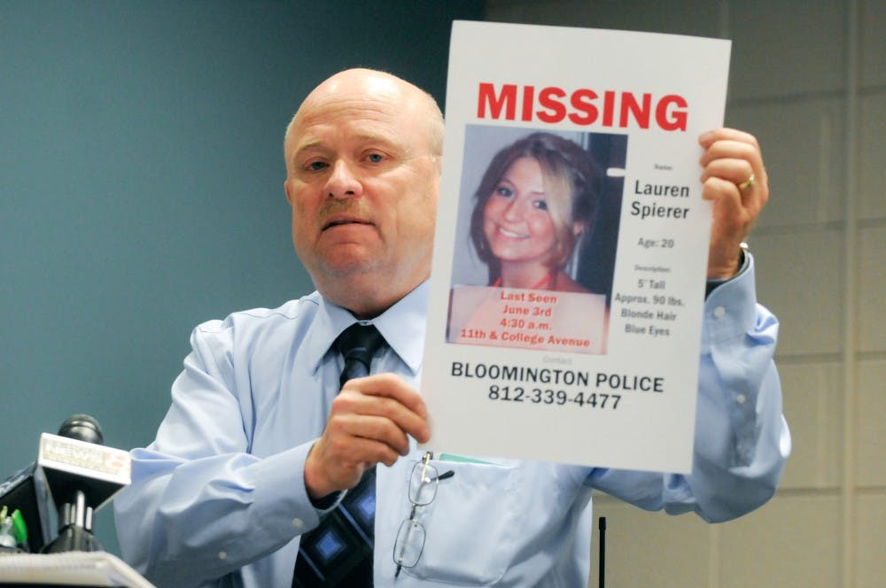 Bloomington Police Department lieutenant of detectives Bill Parker holds up a poster of Lauren Spierer during a press briefing on the fourth day of searches for Spierer in June, 2011.