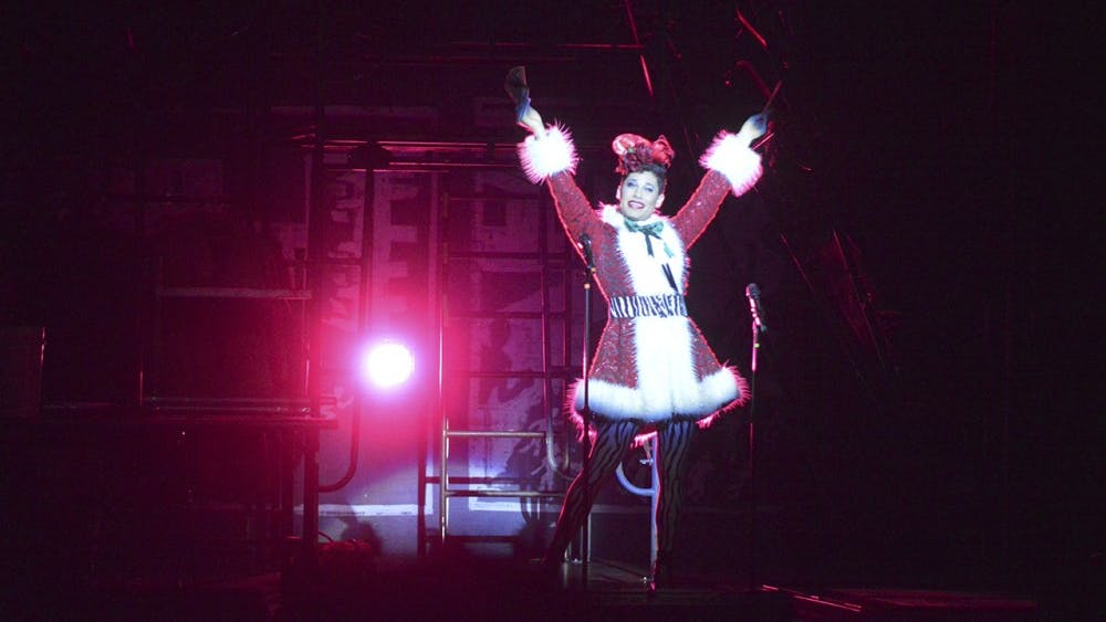"""Angel Schunard played by David Merino enters the scene singing, """"Today 4 U,"""" opening night of Rent's 20th anniversay tour at the IU Auditorium."""