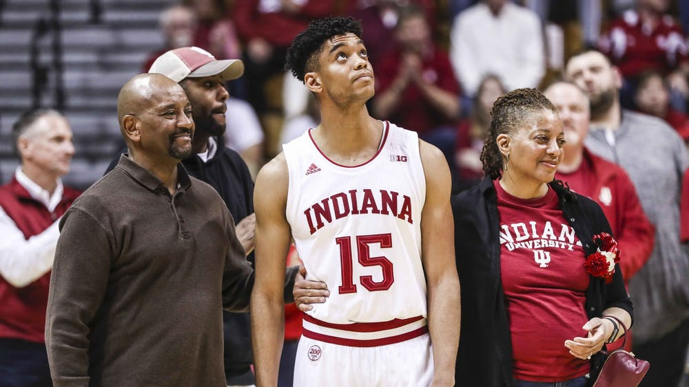 Senior guard Adrian Chapman stands with his family March 7 at Simon Skjodt Assembly Hall. Chapman walked on to the IU men's basketball team as a senior.