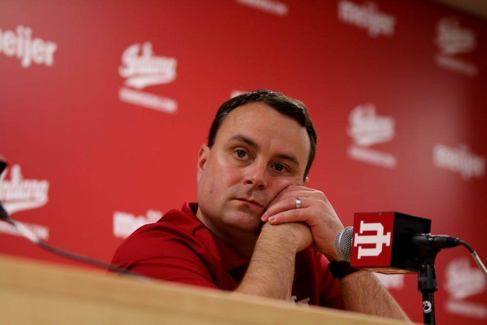 <p>Men's basketball coach Archie Miller rests his head on his hands as he listens to a question during media day Sept. 26. IU begins its 2018-19 season with an exhibition game Thursday against Southern Indiana.</p>