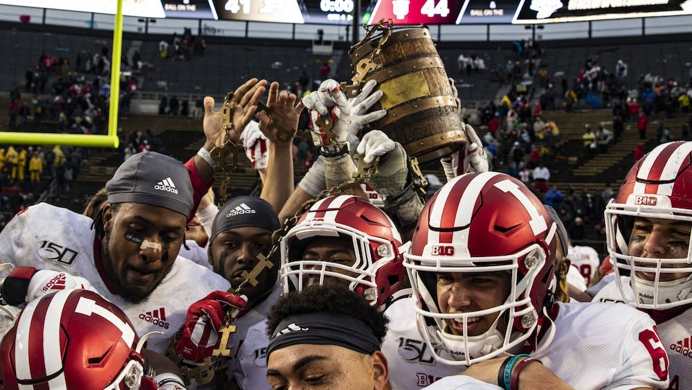 IU football players hold up the Oaken Bucket after defeating Purdue on Nov. 30, 2019, at Ross-Ade Stadium in West Lafayette, IN. Purdue will remain IU's final regular season game after the Big Ten announced revised football schedules Wednesday morning.