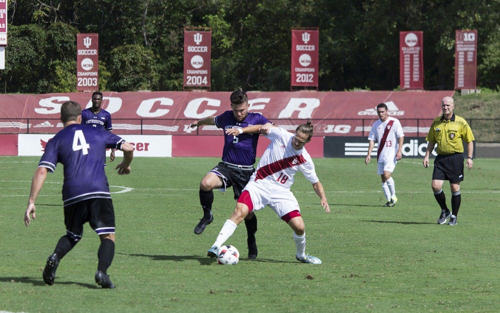 Indiana's Richard Ballard fights for the ball in Sunday afternoon's scoreless Big Ten match up against Northwestern.