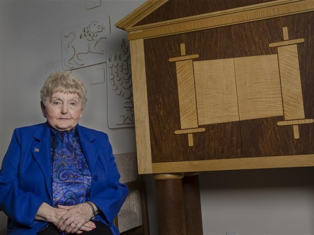 Holocaust survivor Eva Kor poses for a photo at the Helene G. Simon Hillel Center in 2012. Kor died July 4 in Krakow, Poland, on an annual trip tothe former Auschwitz-Birkenau concentration camp.