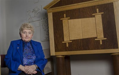 Holocaust survivor Eva Kor poses for a photo at the Helene G. Simon Hillel Center in 2012. Kor died July 4 in Krakow, Poland, on an annual trip to the former Auschwitz-Birkenau concentration camp.