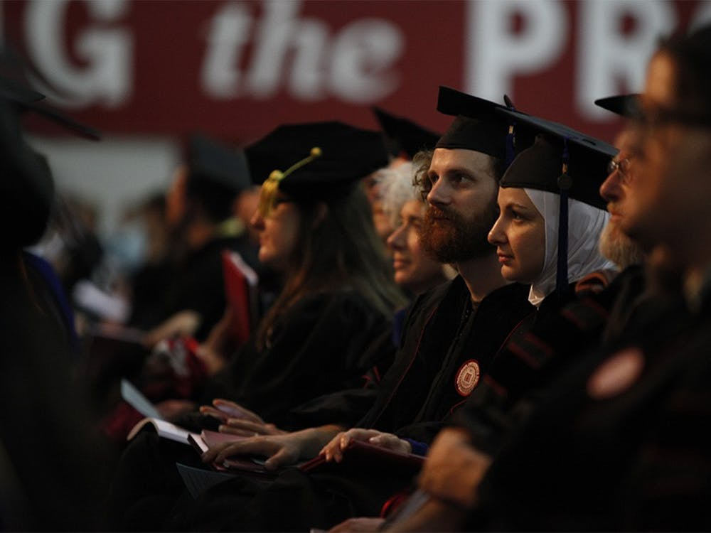 Graduates sit and listen during the commencement speech given by C. David Allis.