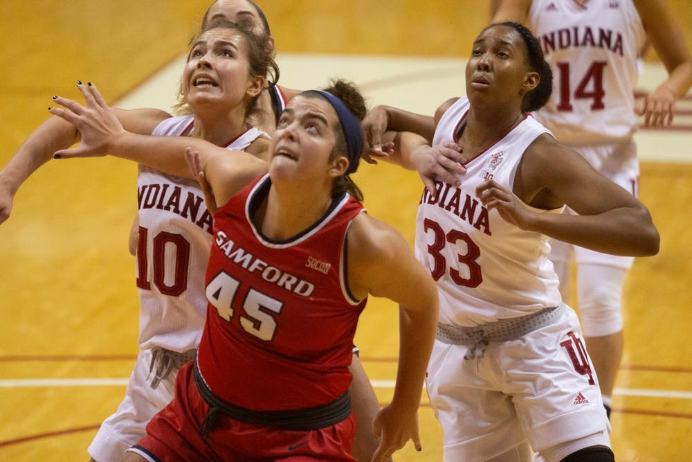 <p>Junior Aleska Gulbe, left, Samford University senior Natalie Armstrong, center and redshirt junior Danielle Patterson, right, play Dec. 3 in Simon Skjodt Assembly Hall. IU deafeated Samford 71-26. </p>