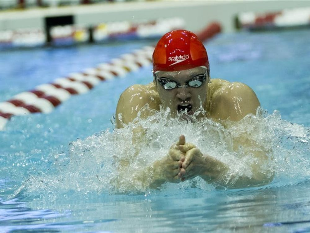 Junior Cody Miller competes in the 100-yard breaststroke event Friday at the Counsilman-Billingsley Aquatic Center. The event, in which Miller placed first with a time of 51:50, was part of the Big Ten Men's Swimming and Diving Championships.