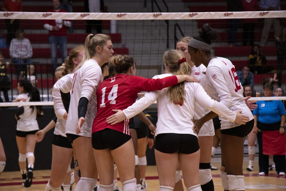 <p>IU volleyball players confer between points during the fifth set against Iowa in Oct. 26 at Wilkinson Hall. IU beat Rutgers on Nov. 9, 3-0. </p>
