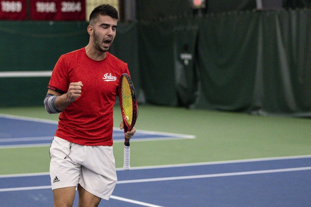 <p>Sophomore Luca Vukovic celebrates during a match against Notre Dame on Feb. 1 at the IU Tennis Center. The Hoosiers won 7-0 against Michigan State on Sunday at home. </p>