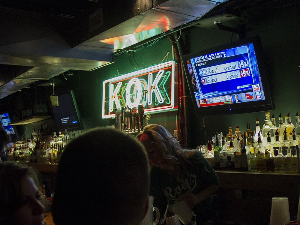 Two bar patrons at Kilroys talk while they watch the presidential election unfold late on Tuesday evening