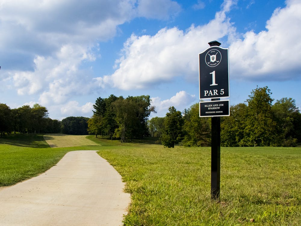 A path runs by the sign for the first hole at the Pfau IU Golf Course. The new course will open to the public June 15.