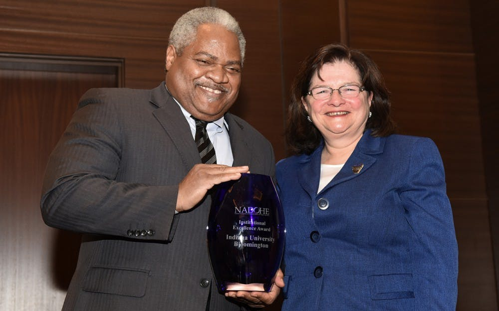 <p>Associate Professor of Business Law&nbsp;Martin McCrory, left, accepts the Institutional Excellence Award from awards chair Carmen Suarez. IU announced that McCrory will resign from his position as&nbsp;associate vice president for the Office of the Vice President for Diversity, Equity and Multicultural Affairs.</p>