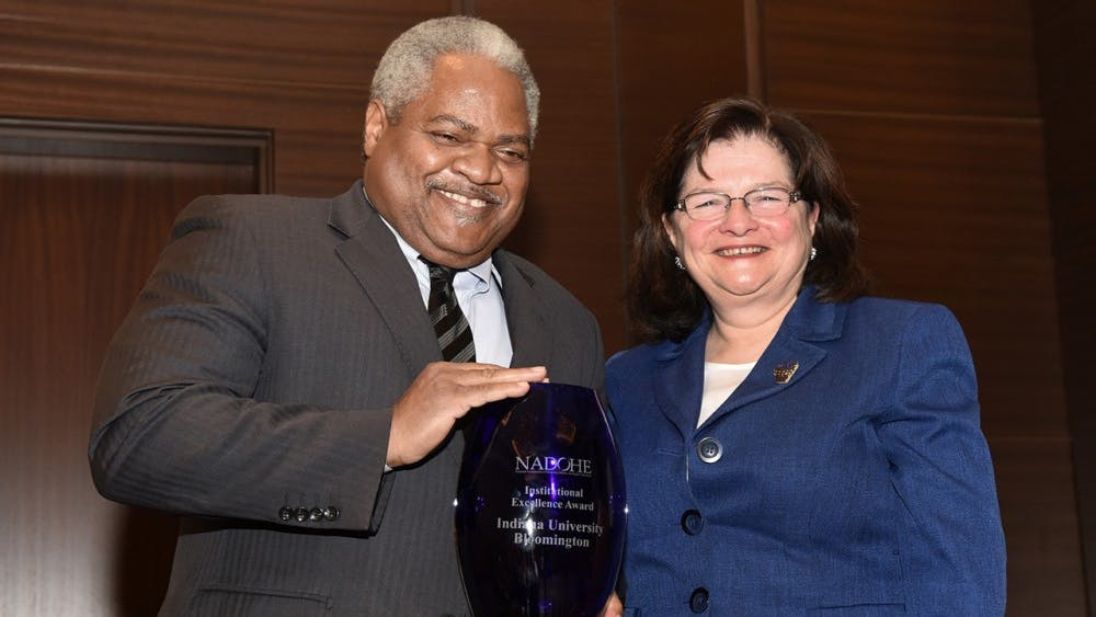 Associate Professor of Business LawMartin McCrory, left, accepts the Institutional Excellence Award from awards chair Carmen Suarez. IU announced that McCrory will resign from his position asassociate vice president for the Office of the Vice President for Diversity, Equity and Multicultural Affairs.