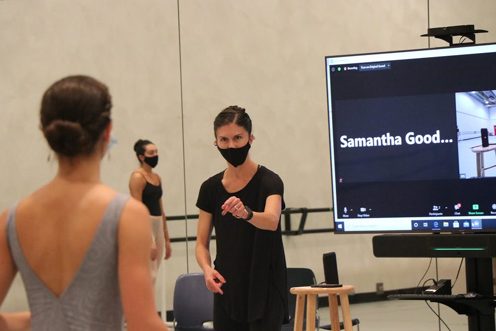 <p>Sarah Wroth, chair of IU&#x27;s ballet department, offers comments on technique to a ballet student Oct. 1 in the Musical Arts Center. Wroth adapted in-person classes for students in quarantine by teaching in front of a Zoom call.</p>