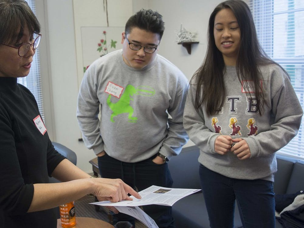 Melanie Castillo-Cullather, director of Asian Culture Center, talks to Evan Chang (middle), 2nd year graduate student, and Malina Xiong, senior in speech and hearing sciences major, before the workshop at Asian Culture Center, Jan 13.