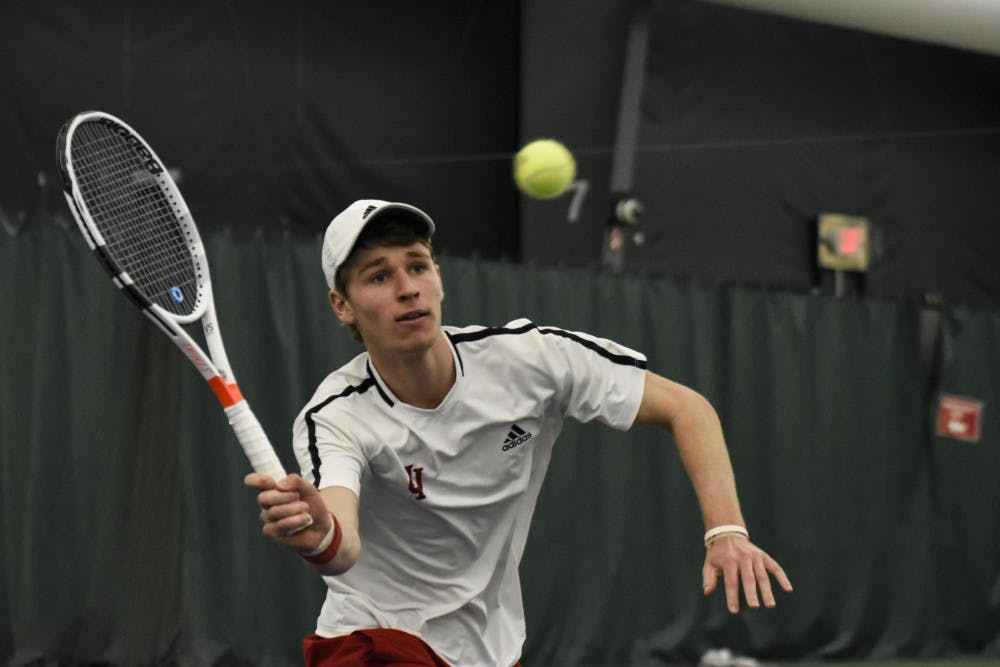 <p>Then-sophomore Bennett Crane reaches for a forehand during his 6-2, 6-7, 4-6 singles loss against Wisconsin during the 2018 season at the IU Tennis Center.</p>