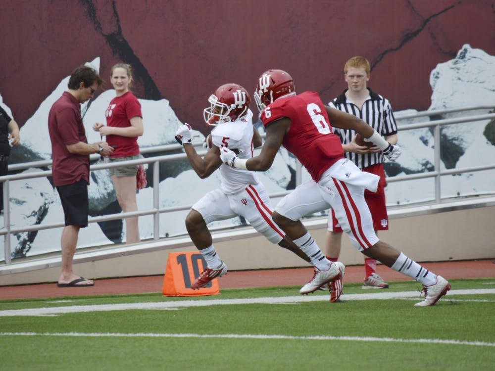 Then-freshman wide receiver J-Shun Harris II, now a junior, runs down the sideline during an April 2015 game at Memorial Stadium. J-Shun Harris was named Big Ten Special Teams Player of the Week on Monday.