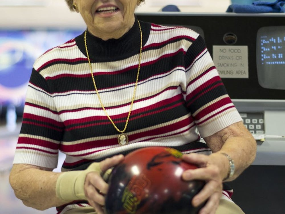 Kay Glazner poses with her bowling ball at the weekly ladies bowling league. Kay is 89 and attends the league every week.