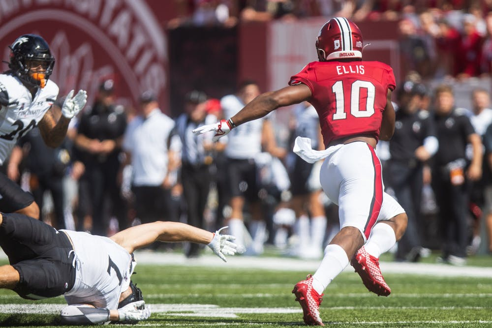 <p>Junior running back David Ellis shrugs off a defender on Sept. 18, 2021, at Memorial Stadium. Ellis is out for the season following an ankle injury. </p>