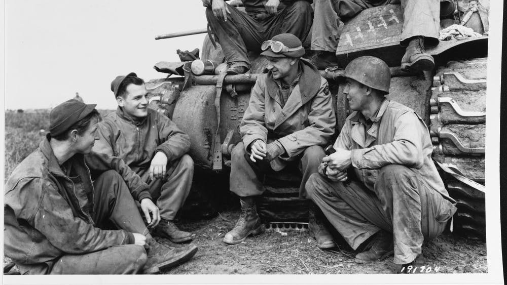 Ernie Pyle visits with a tank crew of the 91st Tank Battalion circa March 1944 in the Anzio Beachhead. Three months later, Pyle would be in Normandy, France.