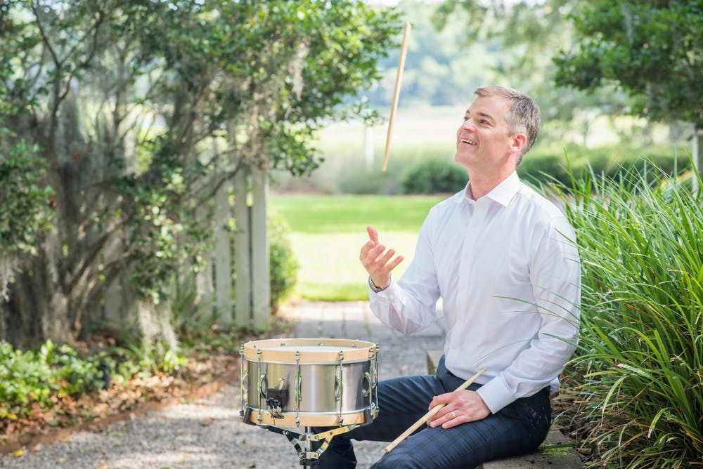<p>A photo of professor Joseph Gramley tosses a drumstickin the air. Gramley began teaching at the Jacobs School of Music this past fall.</p>