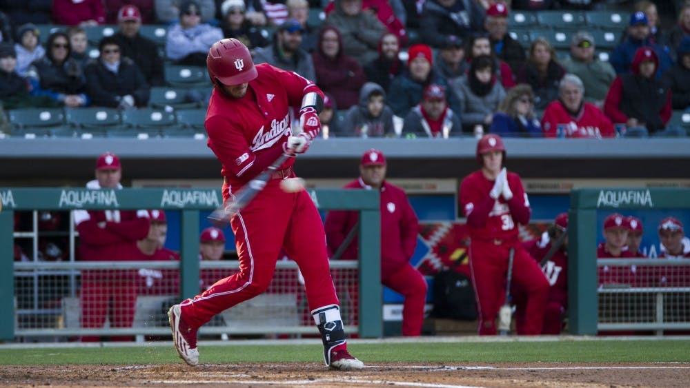 Junior catcher Ryan Fineman hits a home run, bringing Fineman and junior outfielder Logan Kaletha in to score against Notre Dame on April 17 at Victory Field in Indianapolis. IU ended its season with a loss to Texas on Sunday.