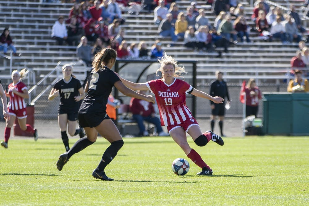 <p>Senior Chandra Davidson tries to move the ball across the field Oct. 27 at Bill Armstrong Stadium. IU beat Michigan State on Wednesday to secure its spot in the Big Ten tournament.</p>