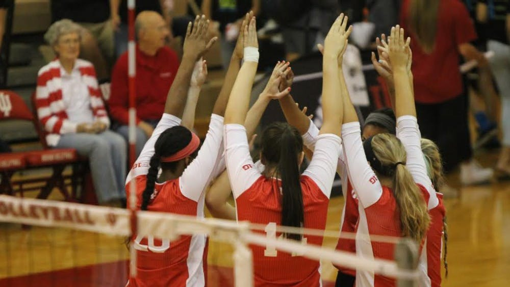 The IU volleyball team huddles during a 2015 game against Bowling Green at the University Gym in Bloomington. The team is 4-1 in 2018 under new coach Steve Aird.
