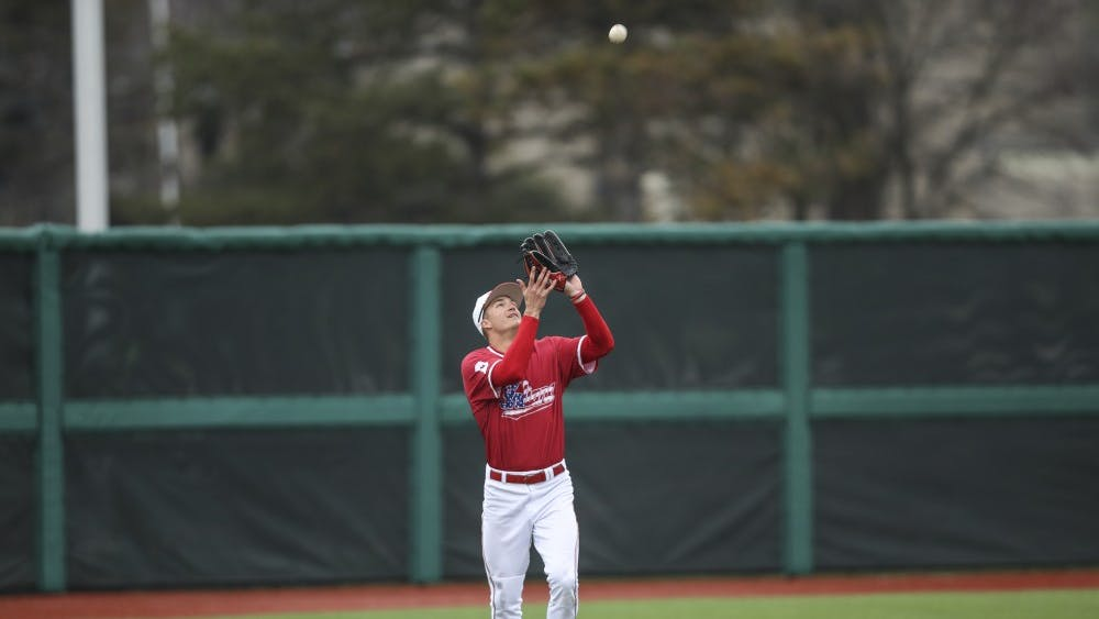 Sophomore Matt Gorski catches a ball in left field during the Hoosiers' game against the Indiana State Sycamores on April 10 at Bart Kaufman Field. IU was selected as the two seed in the Austin regional of the NCAA Tournament on Monday.