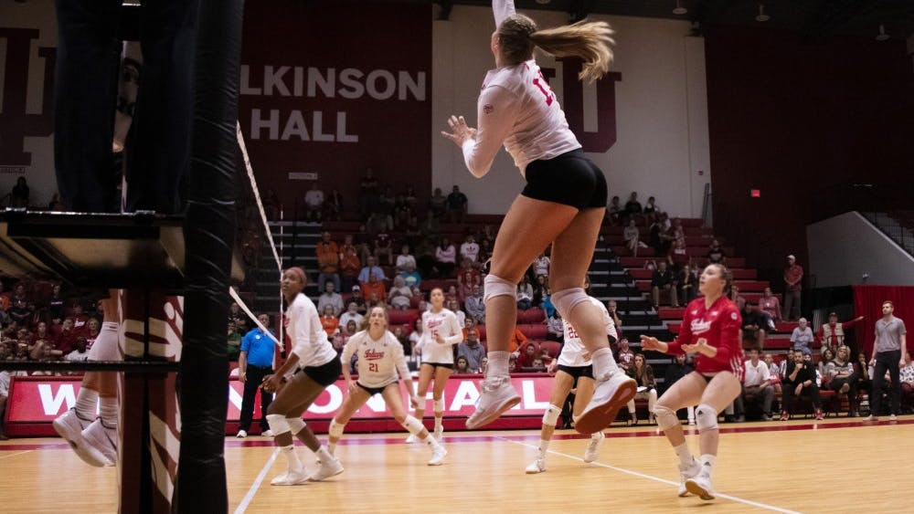 Sophomore outside hitter Breana Edwards spikes the ball against No. 18 Illinois on Oct. 4 at Wilkinson Hall. IU lost to Illinois 0-3.