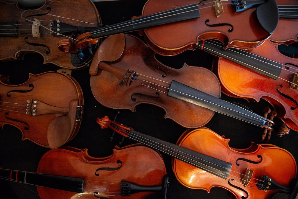 <p>A pile of violins in need of repair at Dobie Middle School in Cibolo, Texas. </p>