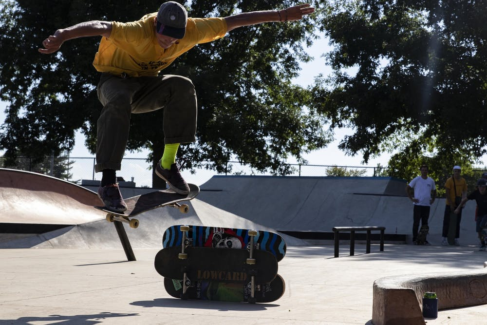 <p>Skateboarder Sam Crawford ollies three stacked skateboards July 25 in Columbus, Indiana. Crawford won first place for best trick in the park toward the end of the contest. </p>