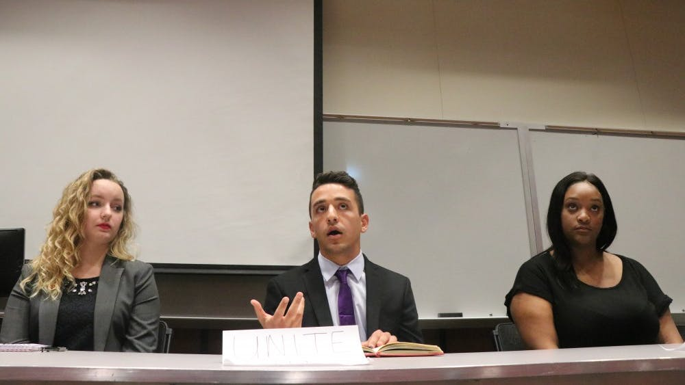 Junior Kevin Mohsenzadeh speaks during the IU Student Association debate Wednesday night in Hodge Hall. Mohsenzadeh is running on the Unite IU ticket for IUSA, and his campaign stands to support for diversity on campus.