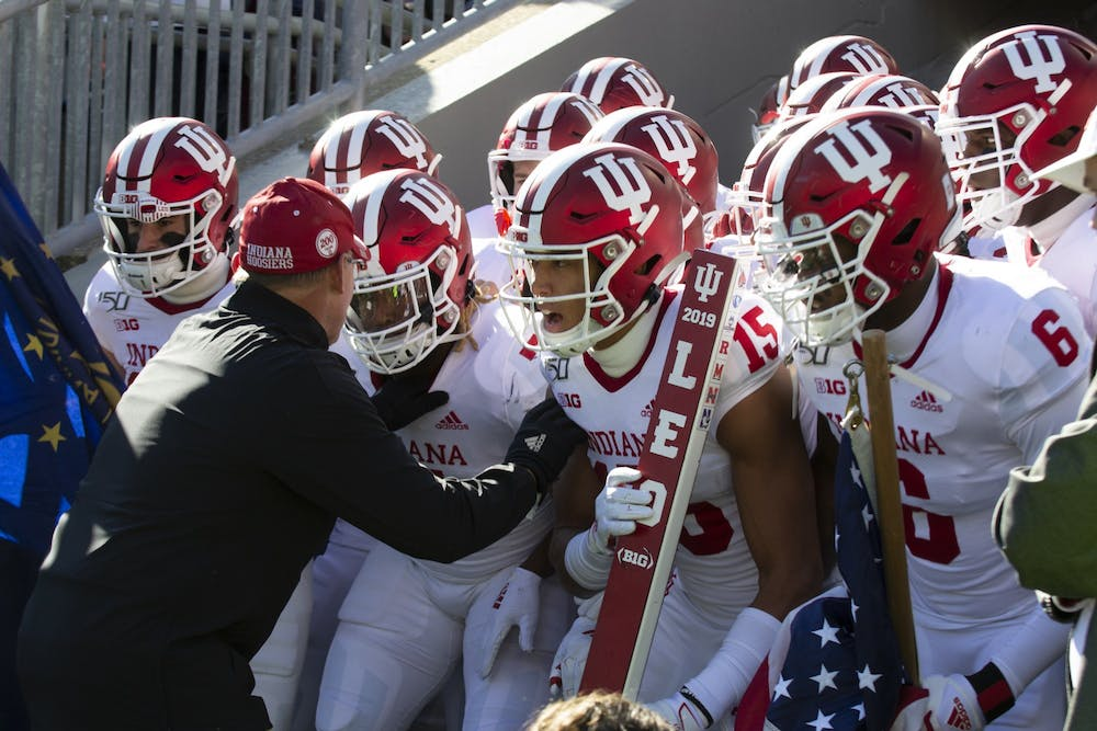 <p>IU head football coach Tom Allen pumps his players up before a game Nov. 16, 2019, at Beaver Stadium in State College, Pennsylvania. Six members of the Hoosiers&#x27; roster declared for the NFL and will not return to play during the 2021-22 season. </p>