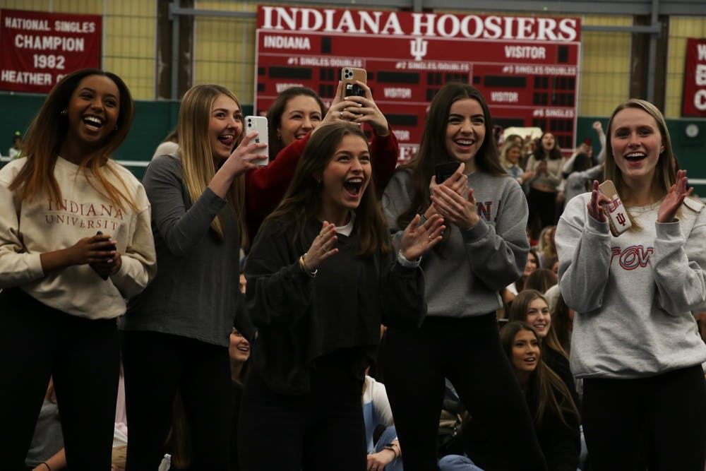 <p>A group of women cheer as they find out which sorority their Rho Gamma leader is in Jan. 21 in the IU Tennis Center. Potential new members did not know which sorority their leader was in during recruitment. </p>