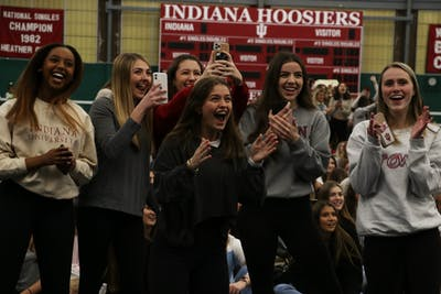 A group of girls cheer as they find out which sorority their Rho Gamma leader is in Jan. 21 in the IU Tennis Center. Potential new members did not know which sorority their leader was in during recruitment.
