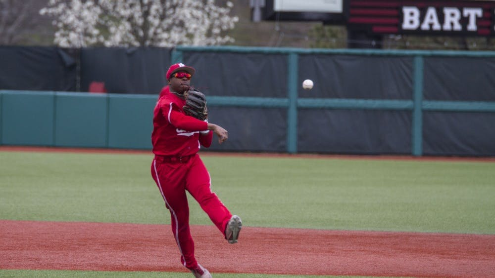 Shortstop Jeremy Houston throws the ball and gets the out on first against Northwestern on April 15. IU will play Louisville on Tuesday night.