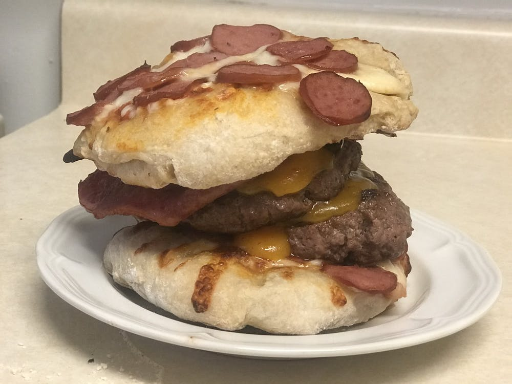 IDS Columnist Bradley Houhlin made the Burgerizza, a concession item at Atlanta's Truist Park. The creation consists of a double bacon cheeseburger with two buns made of pepperoni pizza.