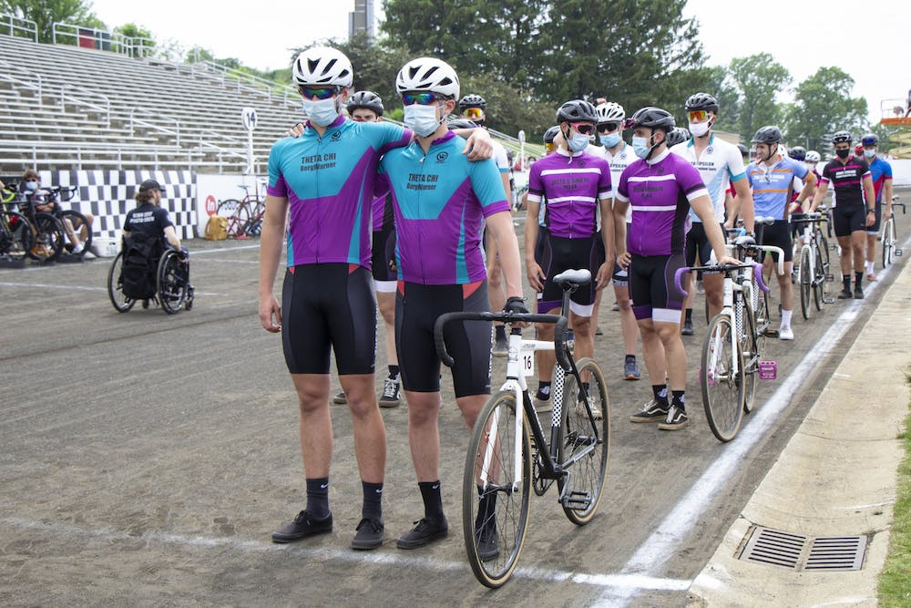 <p>Theta Chi riders stand together prior to the Little 500 on May 26. Theta Chi finished 171 laps despite only having two riders.</p>