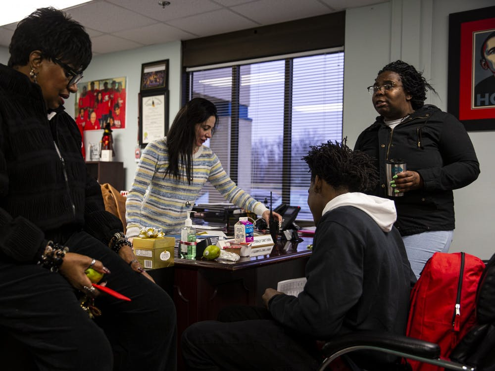 Da'Quincy Pittman is surrounded by Gwendolyn Hardiman, Nicole Fama and his mom Shirley Collins, from left to right. Hardiman is the school's chief of staff, and Fama is the principal and regional director.
