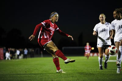 Senior forward Abby Allen kicks the ball to a teammate near the goal Oct. 18 at Bill Armstrong Stadium. IU ended its season with an 8-8-2 record.