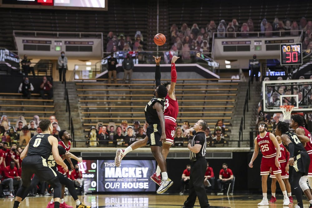 <p>IU sophomore Trayce Jackson-Davis jumps for the opening tip during a game against Purdue on Saturday. Purdue beat IU 67-58.</p>