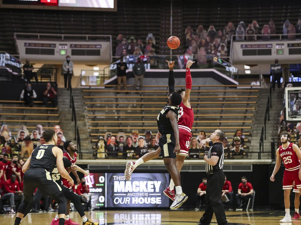 IU sophomore Trayce Jackson-Davis jumps for the opening tip during a game against Purdue on Saturday. Purdue beat IU 67-58.
