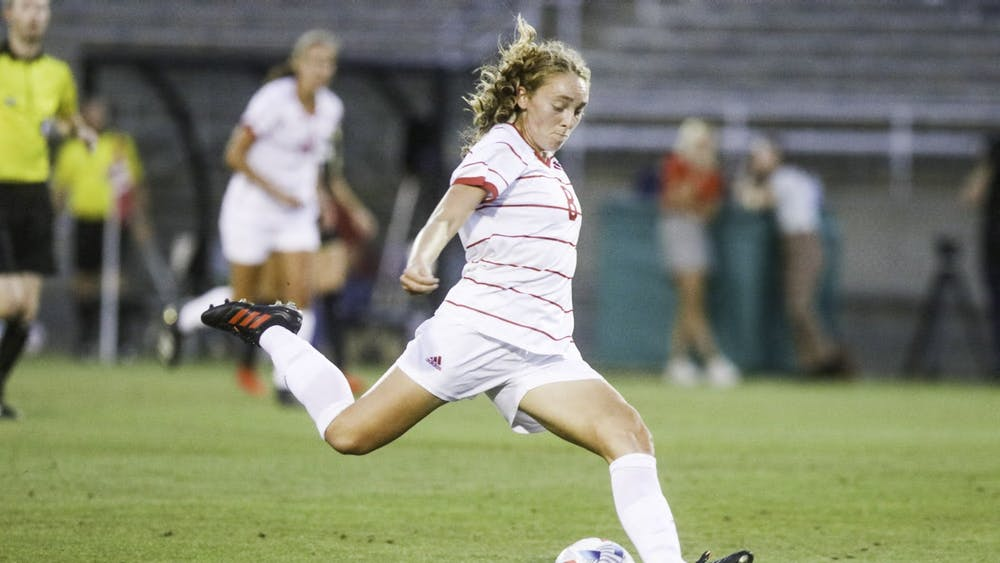 Junior midfielder Avery Lockwood strikes the ball Sept. 2, 2021, in Bill Armstrong Stadium. Indiana won its final non conference game of the season over Kansas State, 3-0.