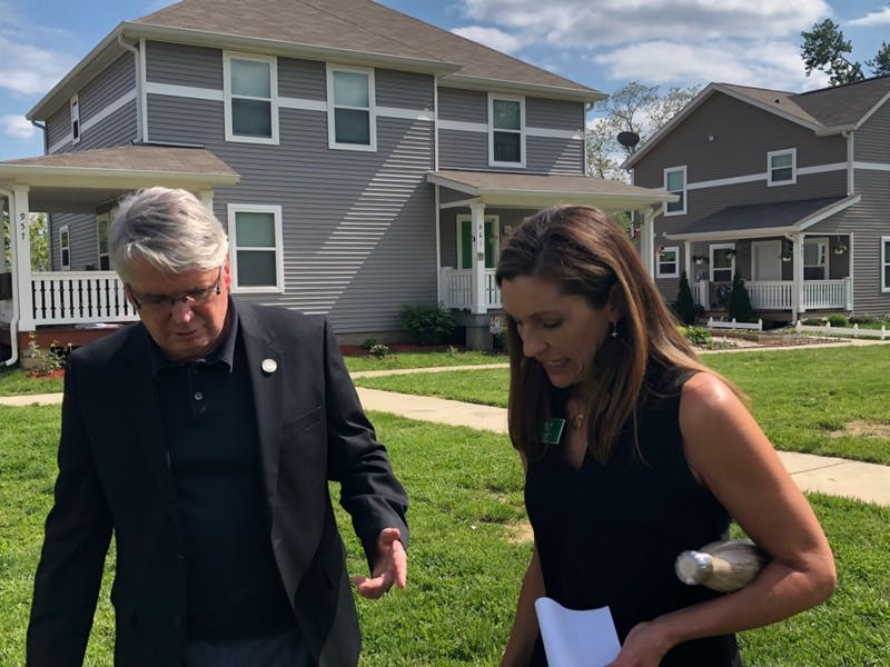Bloomington Mayor John Hamilton and Habitat for Humanity of Monroe County Chief Executive Officer Wendi Goodlett chat at the ceremony in Habitat's Trail View neighborhood Wednesday  announcing the partnership between the City and HFHMC to launch Osage Place. The neighborhood will create about 50 affordable homes.