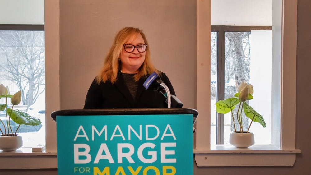 Amanda Barge, then a 2019 Bloomington mayoral candidate, speaks at a press conference Feb. 22 at her campaign headquarters. Barge announced Monday she would be resigning as a Monroe County commissioner following sexual harassment allegations.